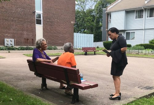 Rachael speaking to two potential Rollins supporters in Roxbury.
